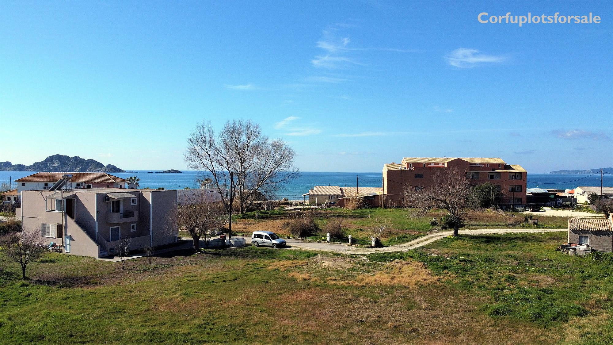 A flat property or land only 140m from Arillas beach