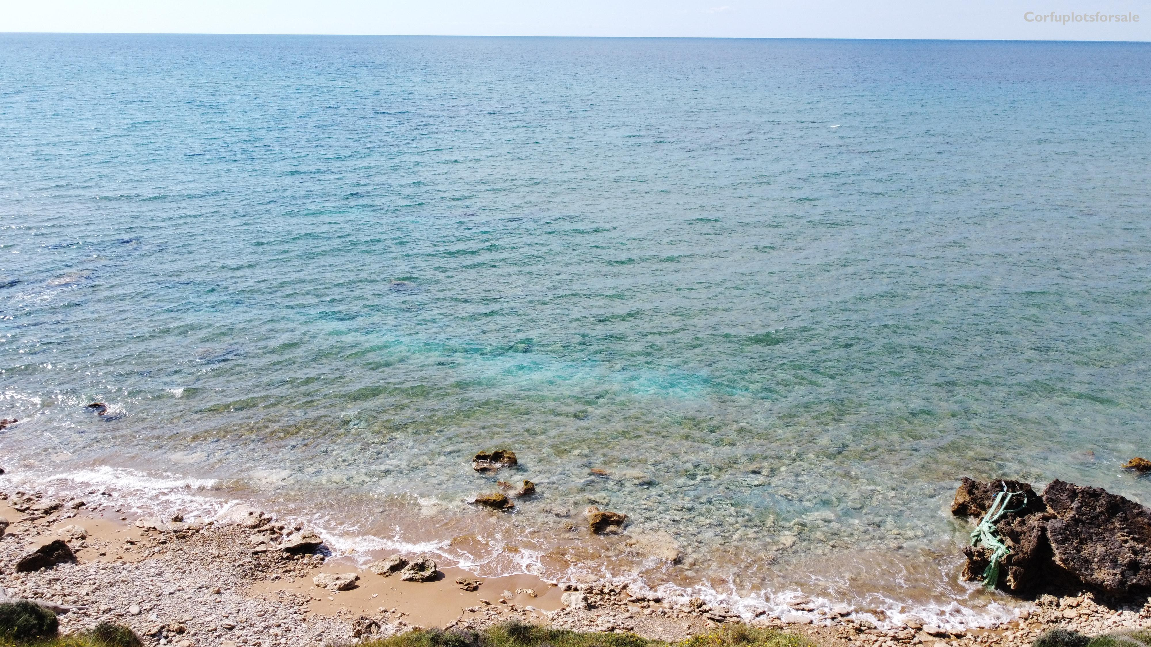 Piece of land in the settlement of Agios Georgios with s small sandy beach