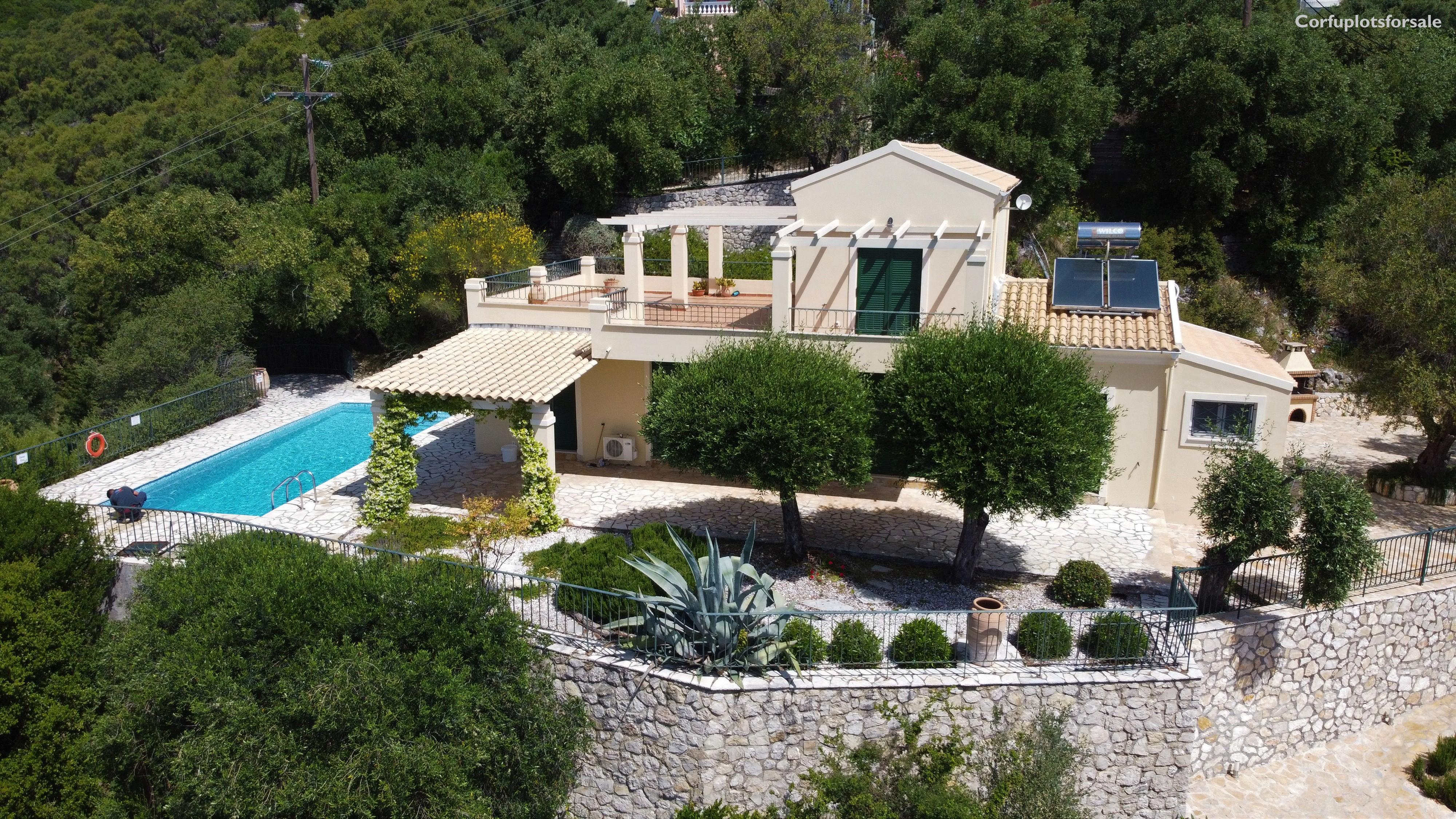 On a hill in Nissaki area 130 sq.m villa with pool